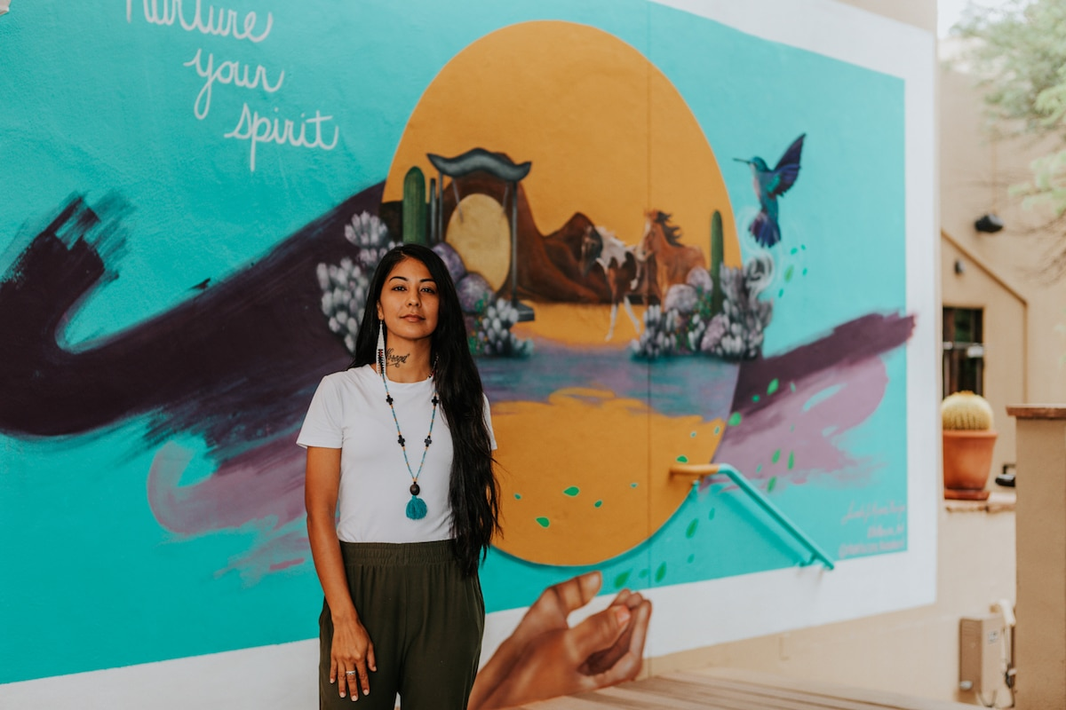 Lucinda Hinojos in Front of Mural at Miraval Arizona