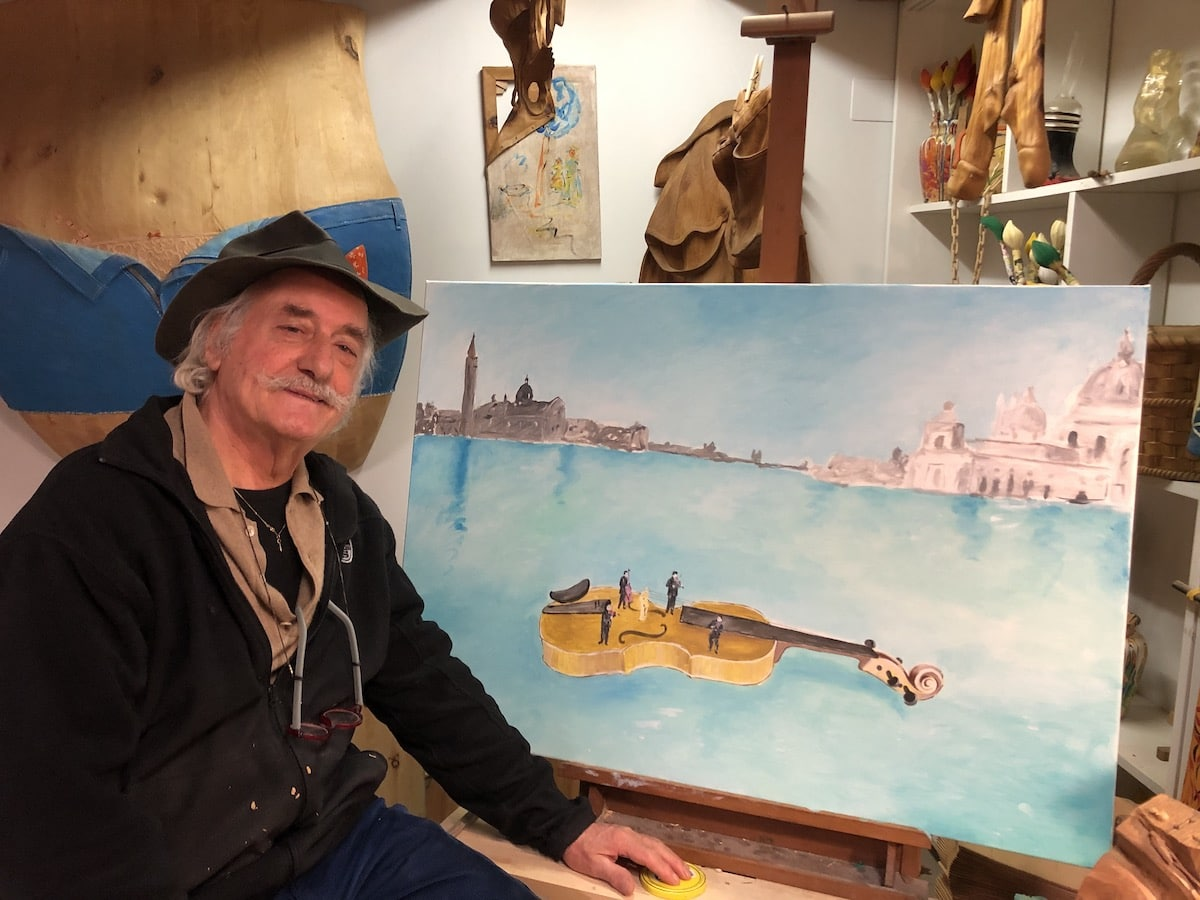 Livio de Marchi with His Painting of a Floating Violin