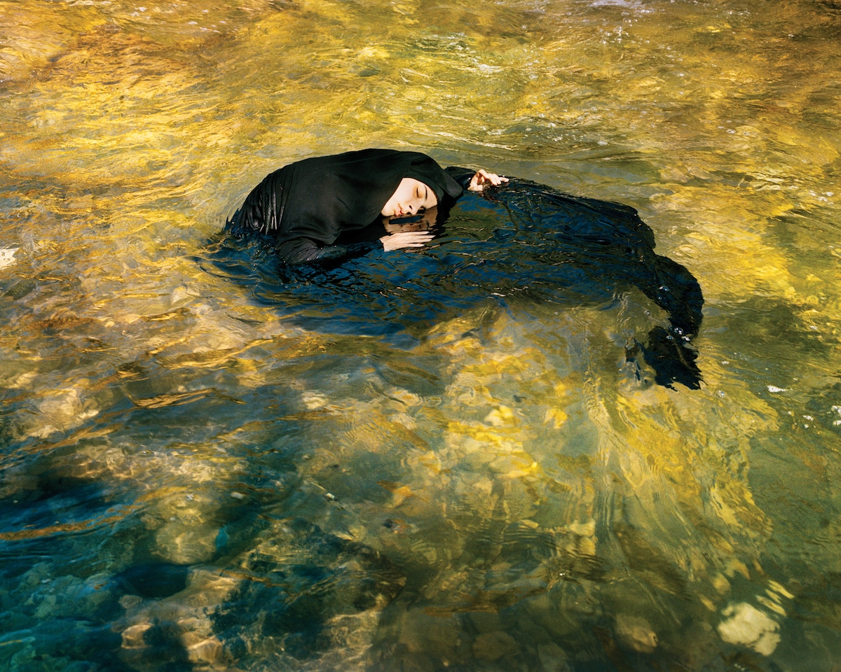 Woman in a Burqa Floating in Water