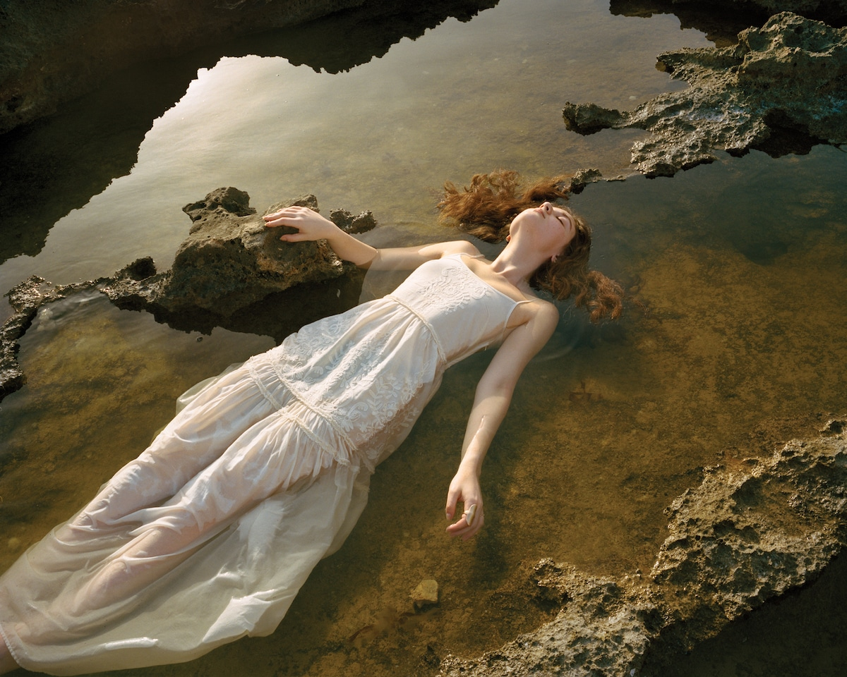 Girl Floating in Water by Rania Matar