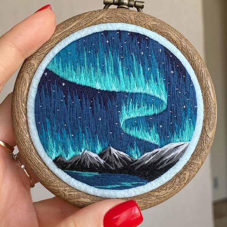 Embroidery Art of a Mountain Landscape and Northern Lights