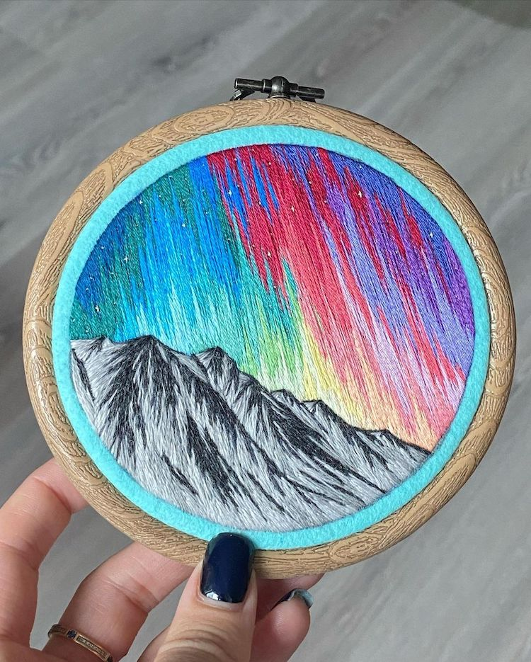Hoop Art Featuring Northern Lights Over Mountains