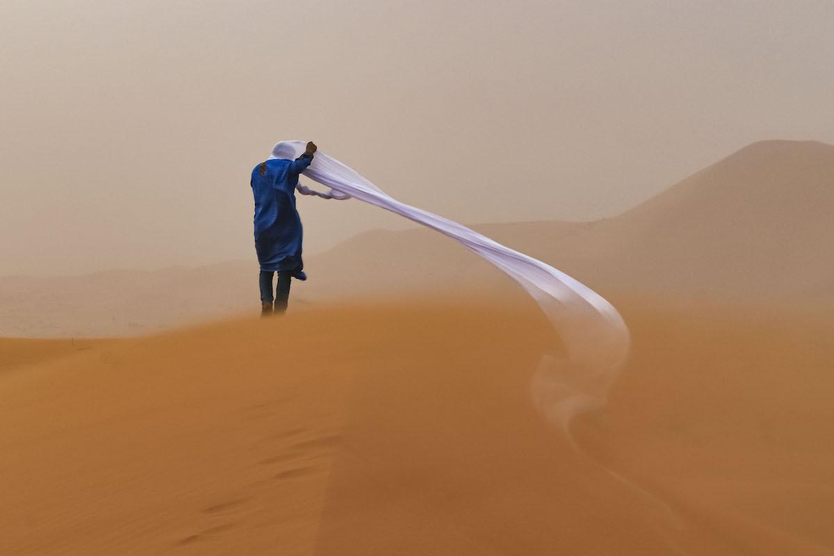 Man in the Sahara Desert During a Sandstorm