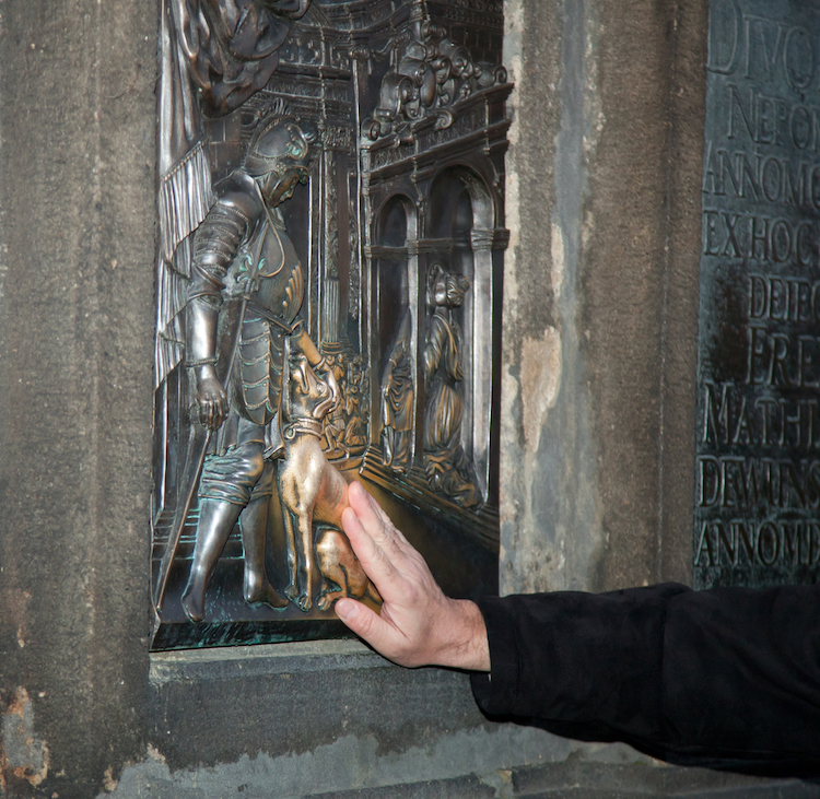 Golden Dog Relief Statue in Prague