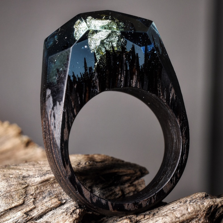 Secret Wood Rings Reveal Miniature Landscapes Encapsulated In Resin - Inside each of these wooden rings is a beautiful hidden world