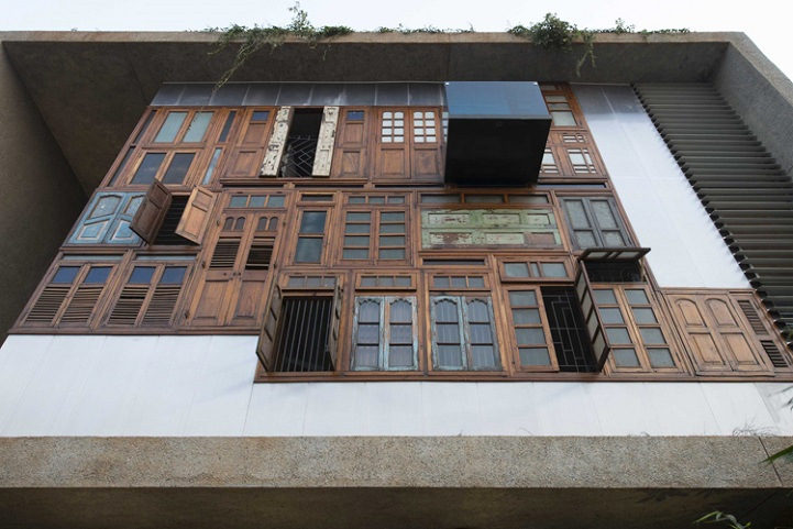 Architects Recycle Found Doors and Windows to Form Faade of