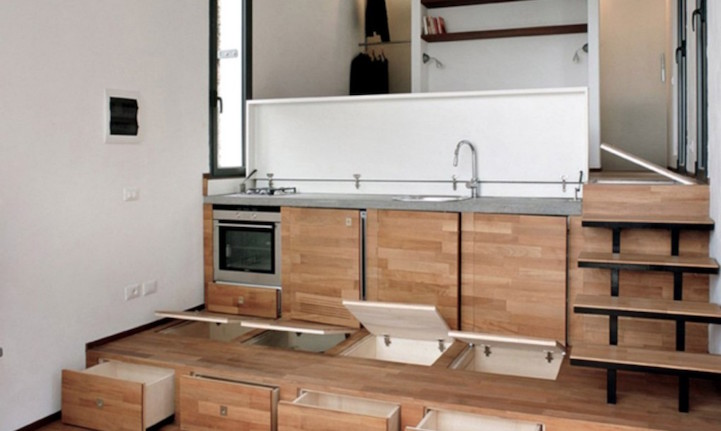 Tiny home cleverly conceals a full size kitchen beneath the stairs