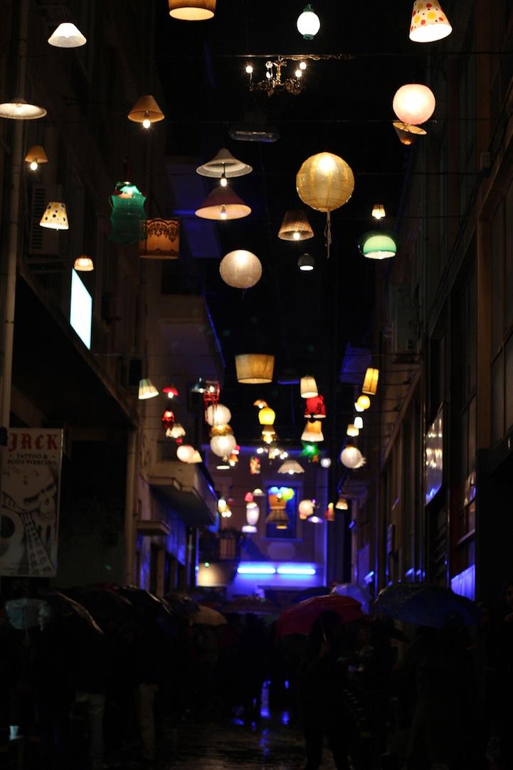 Assorted Light Fixtures Illuminate A Greek City Street