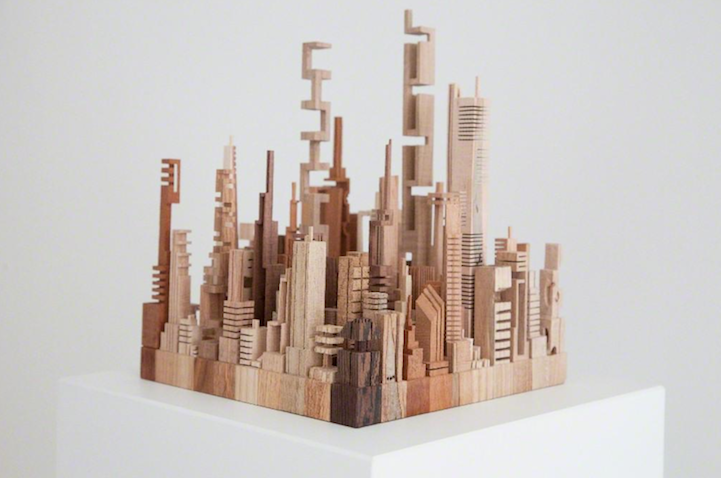 geometric wooden sculptures depict abstract cityscape formations