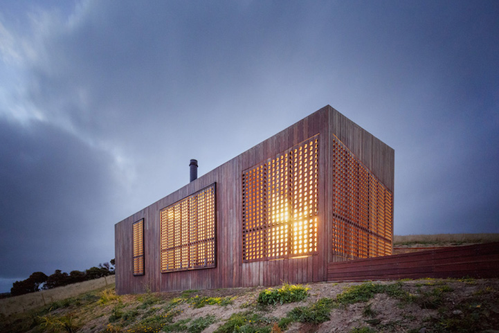 Windy Seaside Cabin Dazzles At Night With Decorative