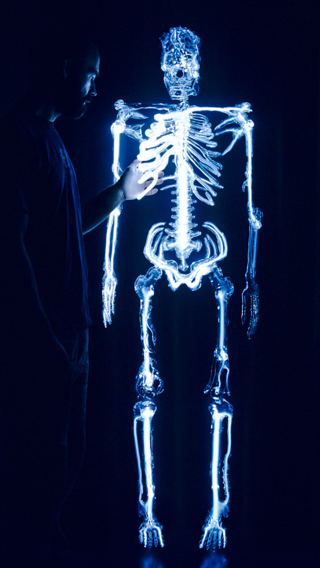 glowing life size glass skeleton sculpture neatorama