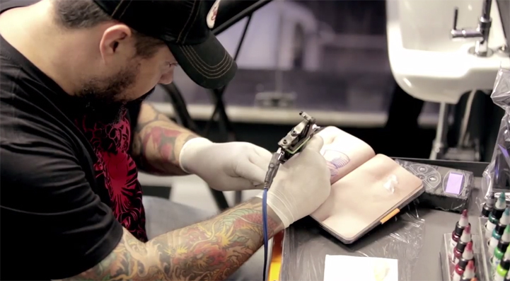 skinbook replaces paper with fake skin for tattooers to practice on. Black Bedroom Furniture Sets. Home Design Ideas