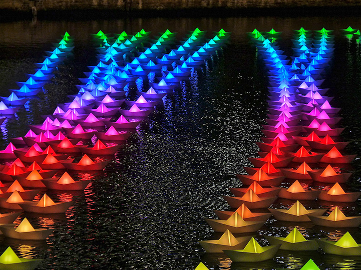 colorful paper boats float across london apos s canary wharf