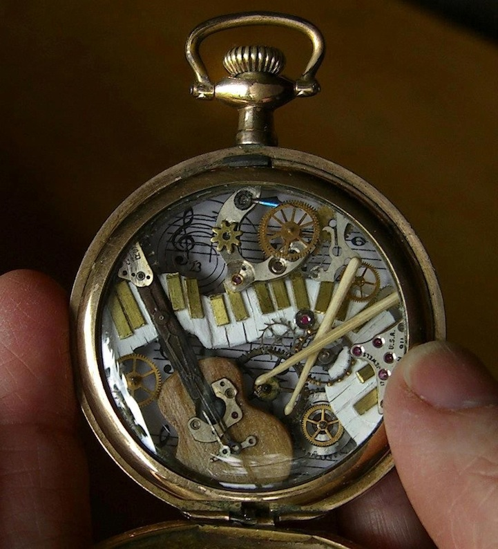 spectacular tiny sculptures made of recycled watches