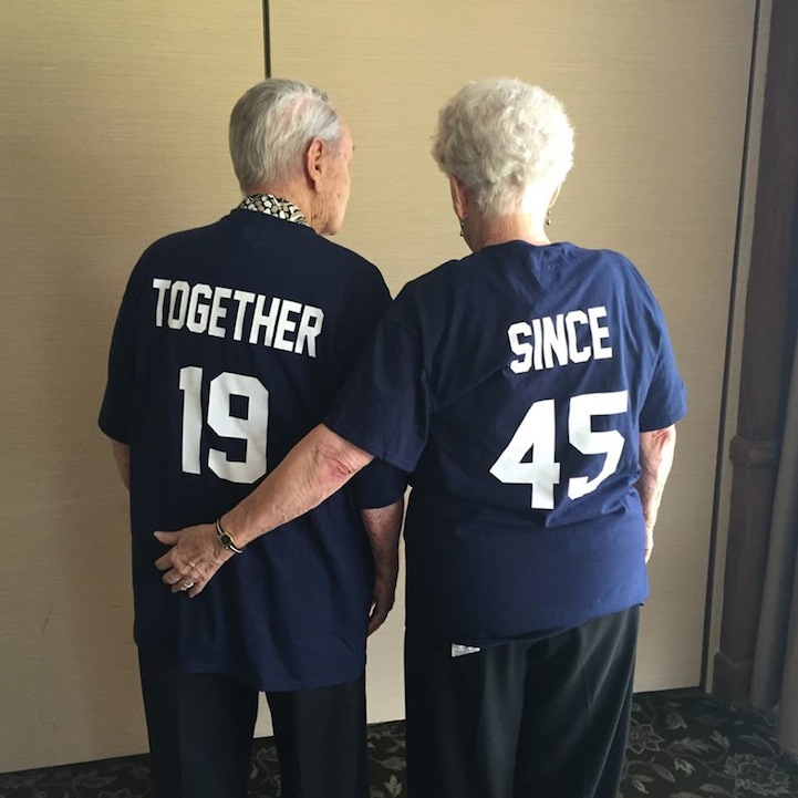 Elderly Couple Root for Different Teams