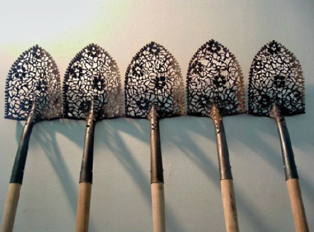 Gardening Tools Contrasted with Intricate Lace Patterns