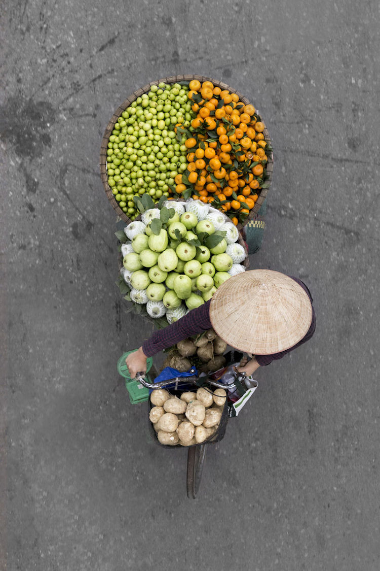 Fruit Vendor In Hanoi Embodies Symmetry And Color