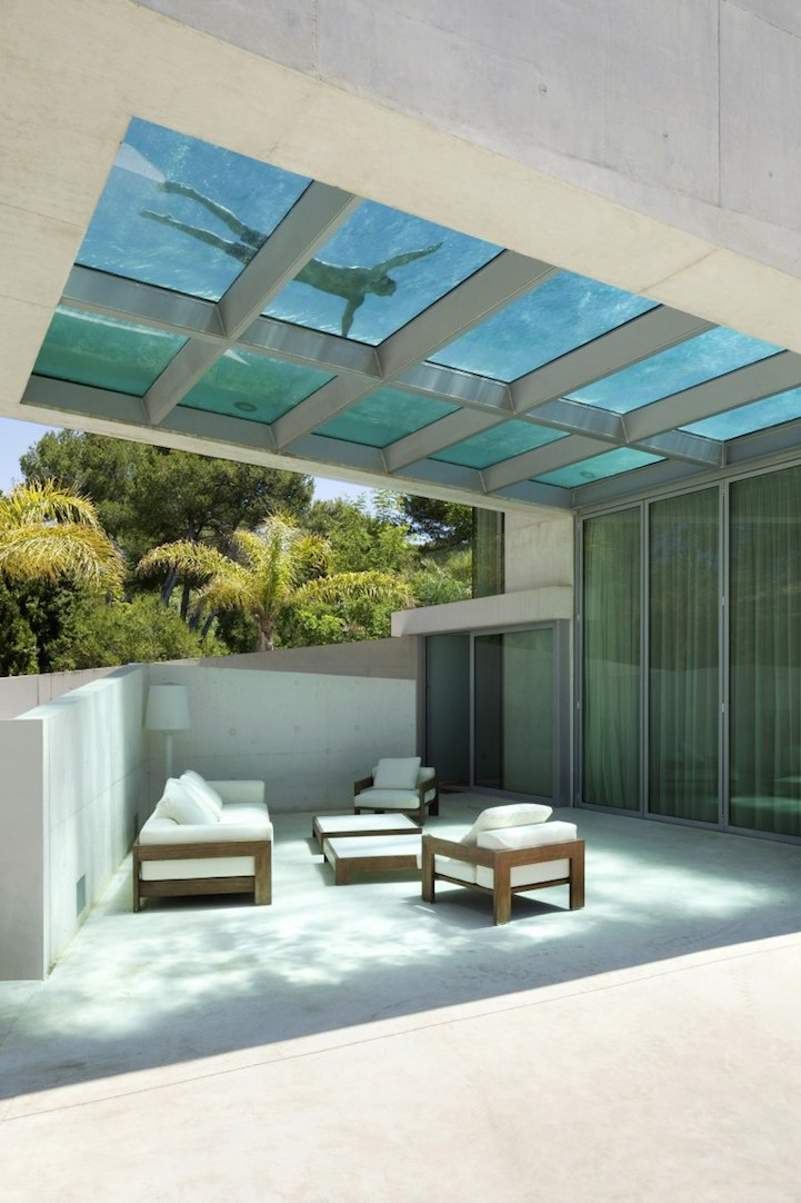 Stunning Spanish Home Built Around Transpa Rooftop Pool