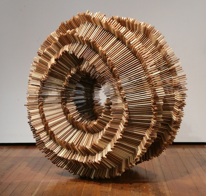 Hundreds of Pieces of Stacked Wood Form Beautifully Organic Sculptures