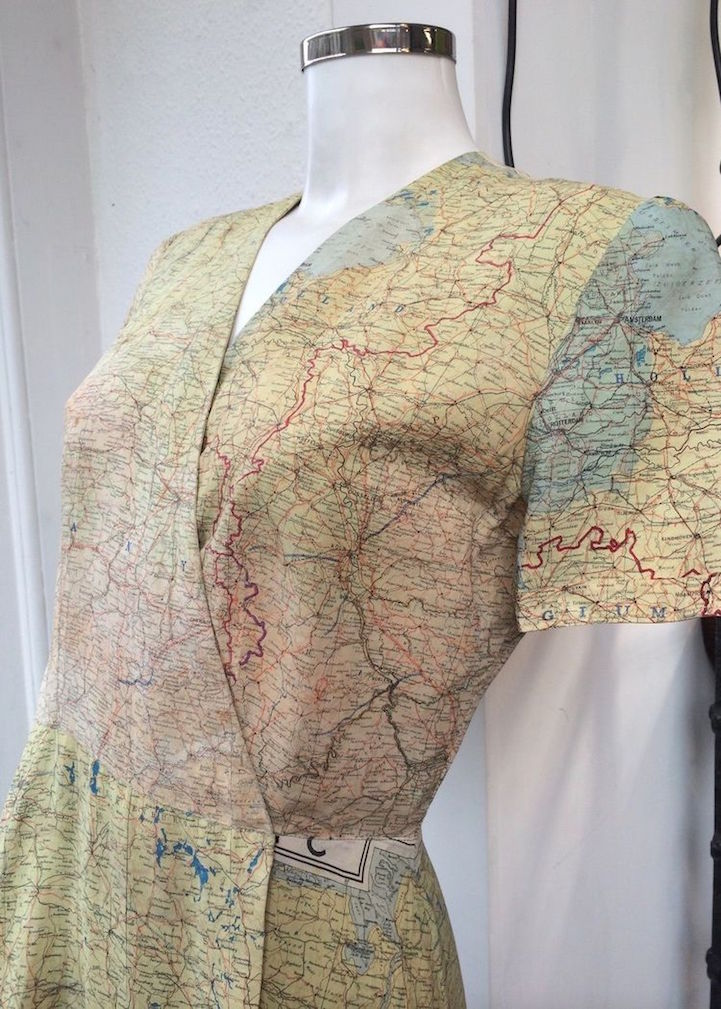 Wedding Dress Made From World War II Escape Map Has a New ... on map black, map rail, map blouse, map travel, map jacket, map skirt, map sweatshirt, map art, map vest, map clothing, map fabric, map shirt, map costume, map games, map school, map shoes, map history, map with title, map pants,