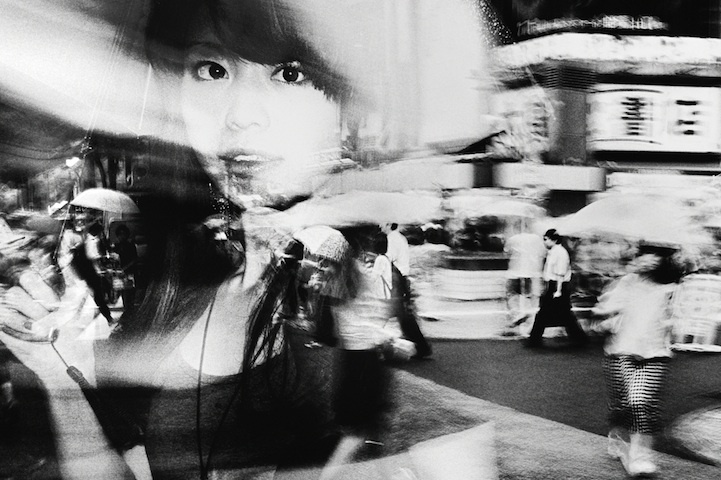 Japanese photographer tatsuo suzuki captures the dynamic energy of tokyo in his gritty black and white street photos with a background in law at the