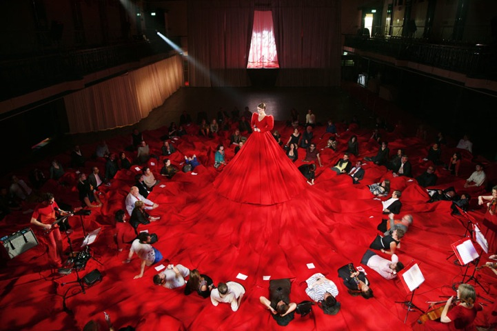 Sitting On A Giant Red Dress