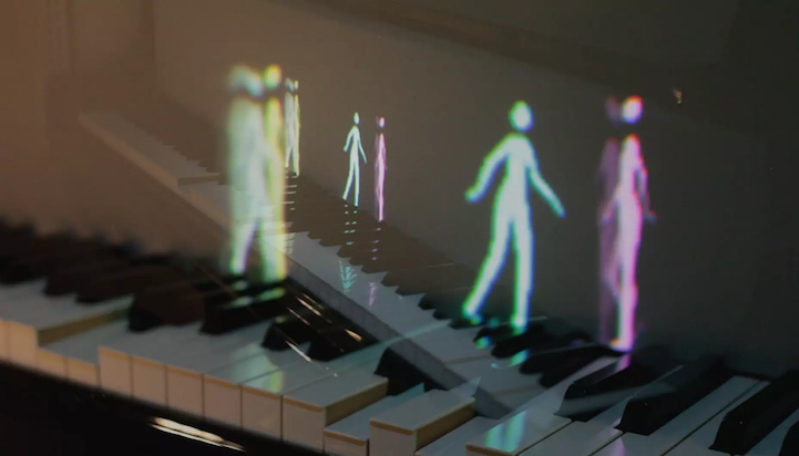 Animated Light Projections of Tiny People Seem to Play the