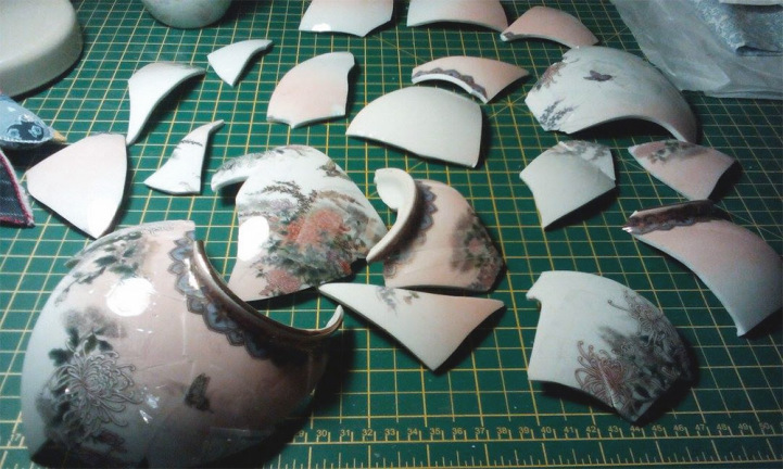 Broken Vases Are Restored by Sewing Them Back Together with Gold Thread