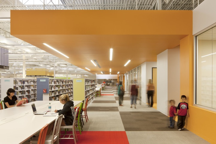Former walmart transformed into modern library space for Modern library building design