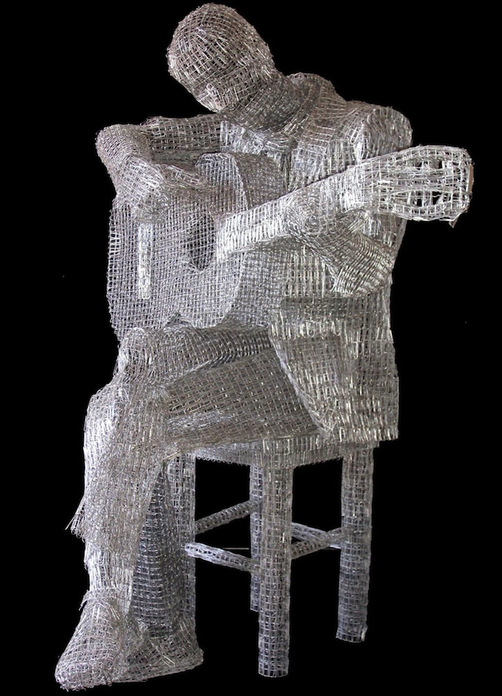 artist links thousands of paperclips to form sculptures