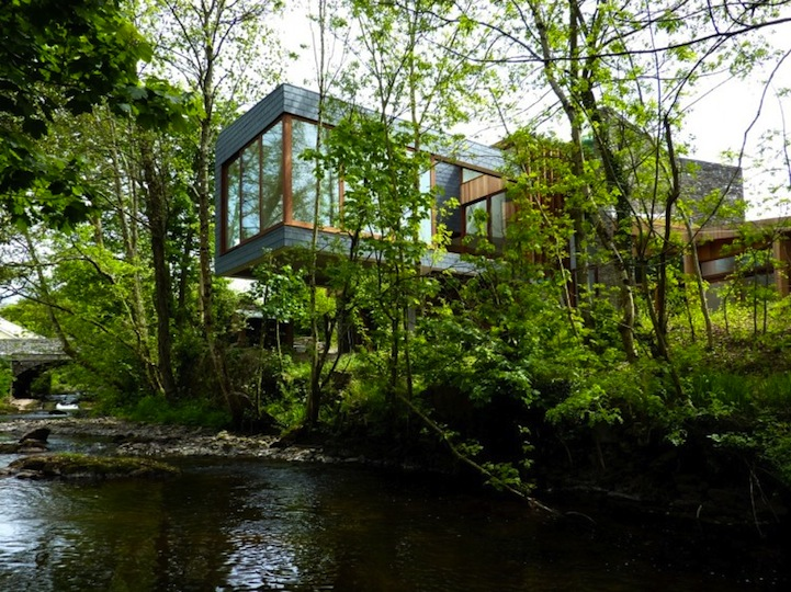 Contemporary Home Hangs Over River