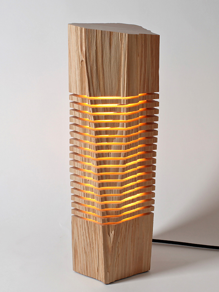 sliced sculpture lamps highlight  natural beauty