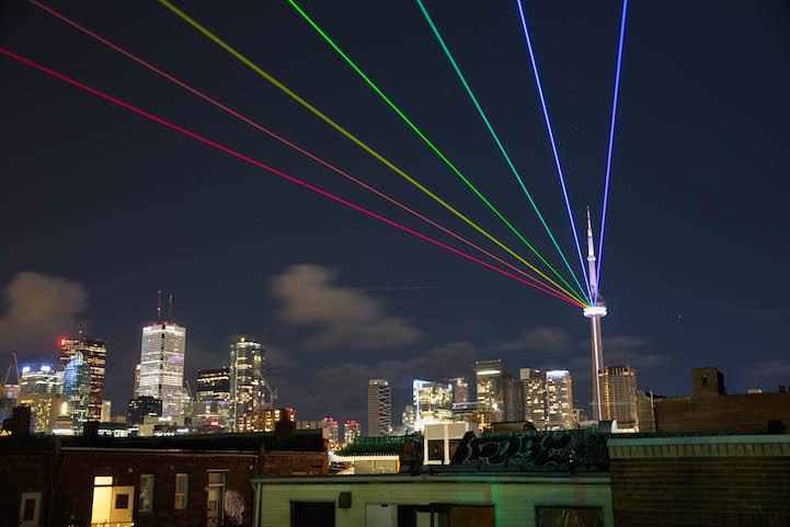 Powerful Laser Rainbow Beams Onto Torontos CN Tower
