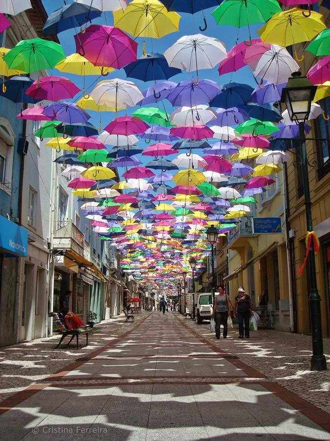 & New Colorful Canopy of Umbrellas Graces the Streets of Portugal