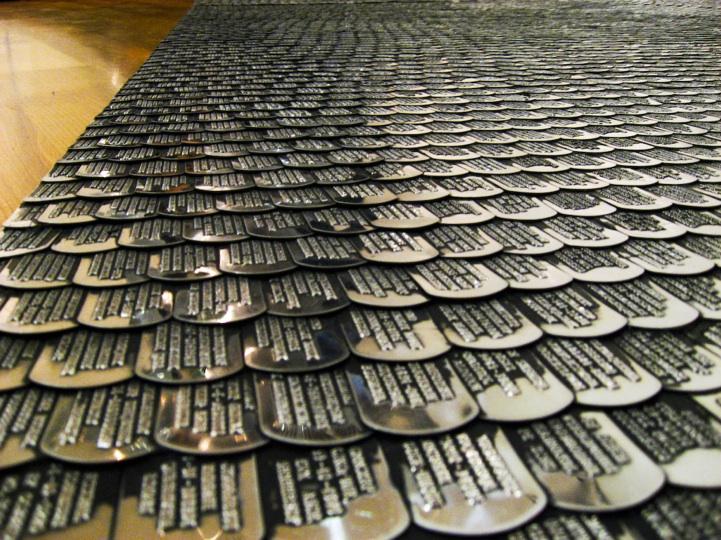 thousands of dog tags make a symbolic robe