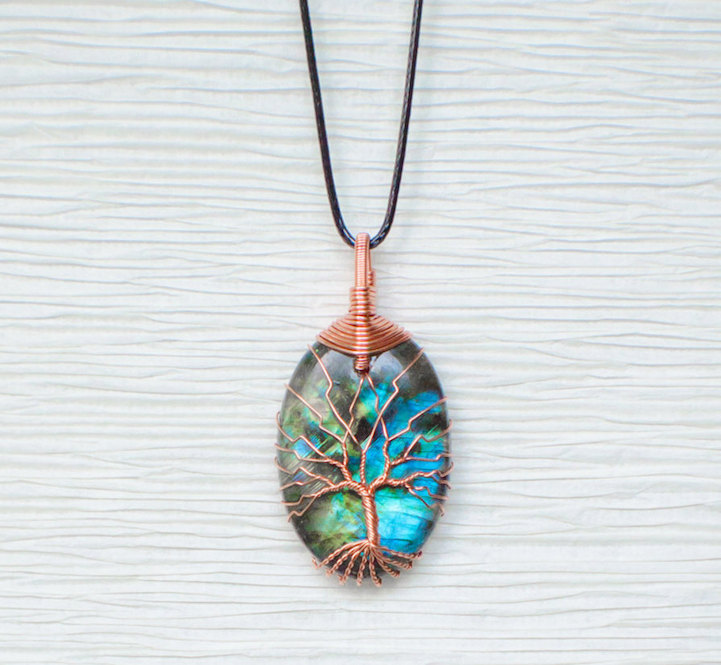 Discarded copper wire twisted into trees to beautifully frame discarded copper wire twisted into trees to beautifully frame dazzling stone pendants aloadofball Choice Image