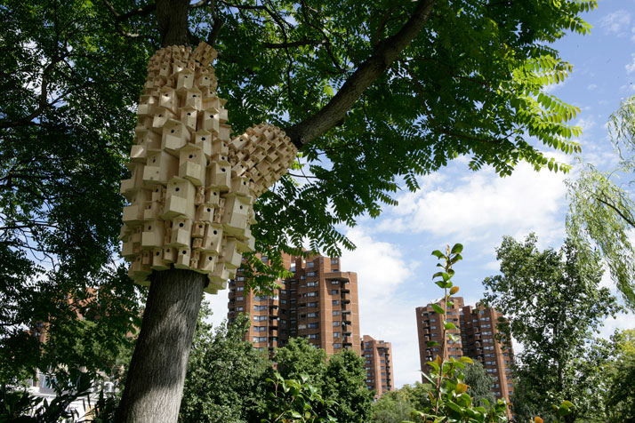 Clusters of birdhouses fantastically wrap around trees for Garden trees london