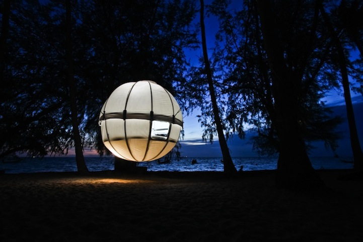 Cocoon Tree website via [Ignant] & Modern Spherical Tent Floats Among the Trees