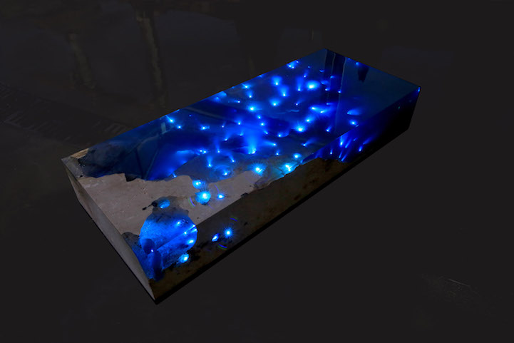 natural stone and resin table brings the beauty of a starry night on