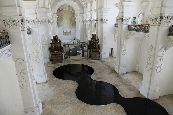 Pools Of Recycled Motor Oil Reflect Spectacularly In