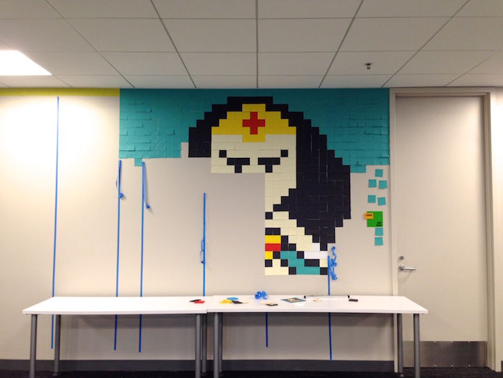 8024 post it notes cover drab office walls in pixelated superheroes - Pixelated Interior Design
