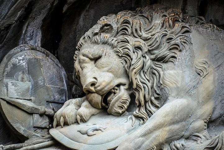 Symbolic lion sculpture carved laying in a cliff