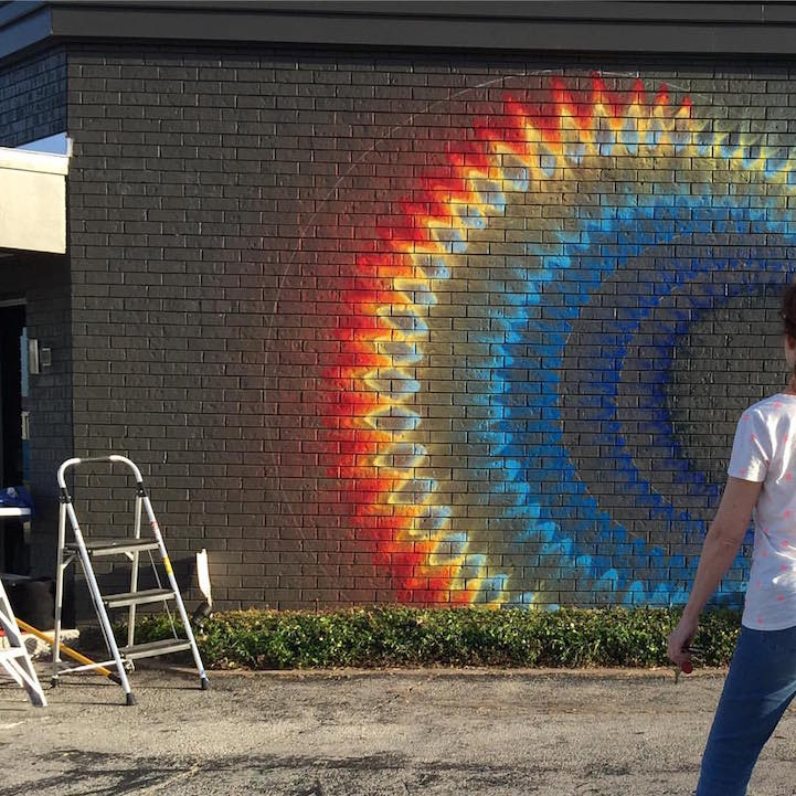 hypnotic graffiti murals radiate colorful illusions of
