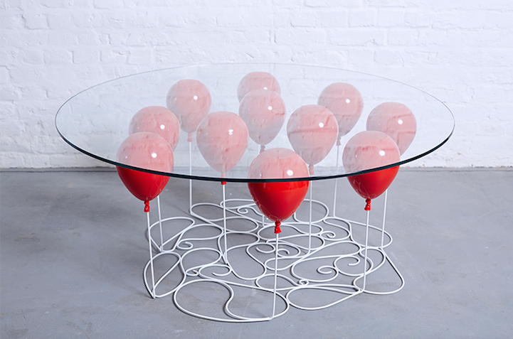 Playful coffee table creates the illusion that it 39 s held for Balloon decoration courses in london