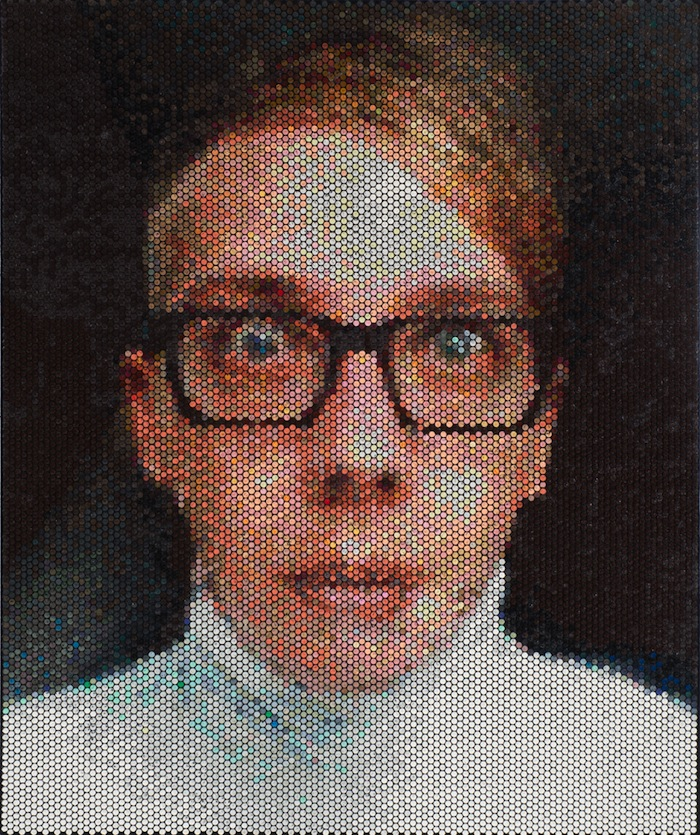 injecting paint in bubble wrap to create pixelated portraits
