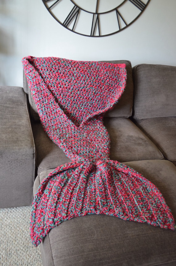 Artist playfully redesigns cozy blankets as crocheted mermaid tails dt1010fo