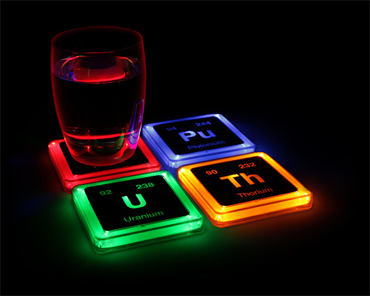 Radioactive Elements Coasters Emit An Electric Glow When You Set Your Drink On Them
