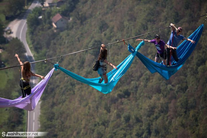 Adventurous Climbers Suspend Themselves In Hammocks Across
