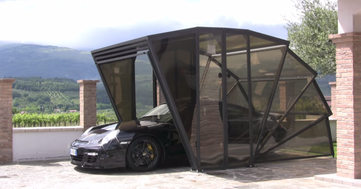 Enclosed Motorcycle Shelter : Foldable transparent carport protects and shows off prized