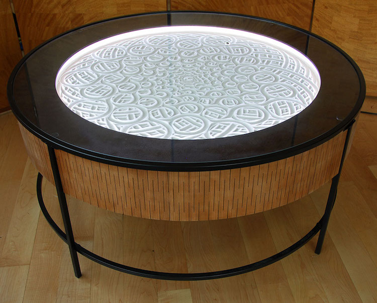 New kinetic art tables draw hypnotic designs in sand for Design table new york